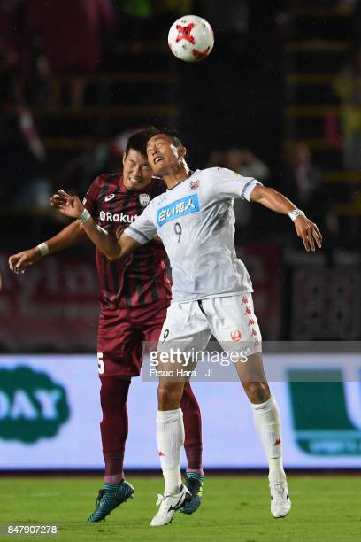 Ken Tokura of Consadole Sapporo and Takuya Iwanami of Vissel Kobe compete for the ball during the JLeague J1 match between Vissel Kobe and Consadole...
