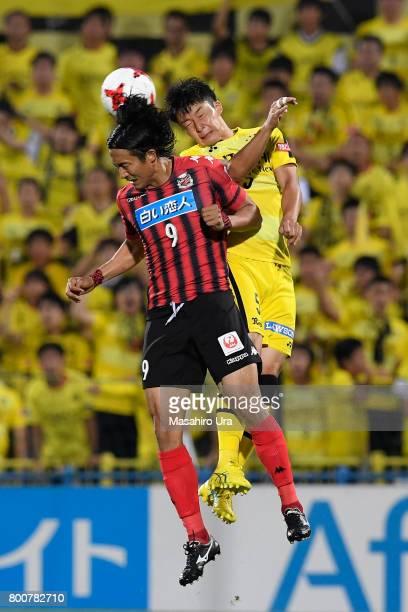 Ken Tokura of Consadole Sapporo and Yuta Nakayama of Kashiwa Reysol compete for the ball during the JLeague J1 match between Kashiwa Reysol and...