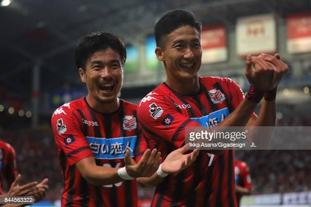 Ken Tokura of Consadole Sapporo celebrates scoring his side's first goal with his team mate Ryota Hayasaka during the JLeague J1 match between...