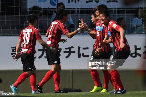 Ken Tokura of Consadole Sapporo celebrates scoring his side's second goal with his team mates during the JLeague J1 match between Jubilo Iwata and...