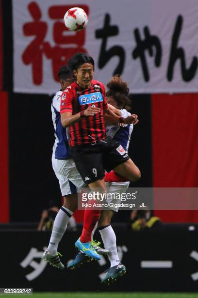 Ken Tokura of Consadole Sapporo competes for the ball against Fabio and Hiroki Fujiharu of Gamba Osaka during the JLeague J1 match between Consadole...