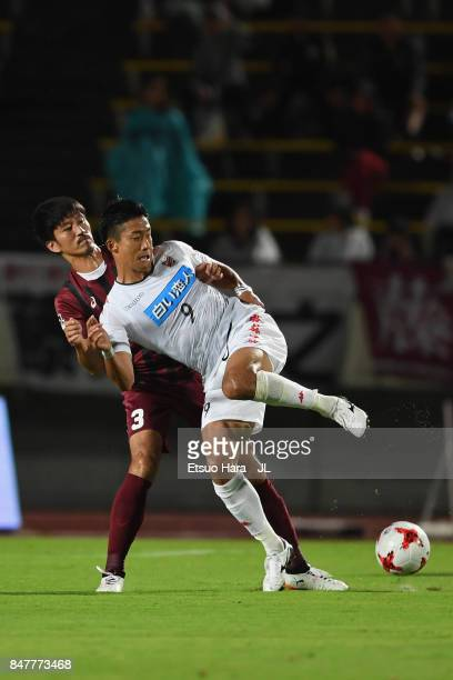 Ken Tokura of Consadole Sapporo controls the ball under pressure of Hirofumi Watanabe of Vissel Kobe during the JLeague J1 match between Vissel Kobe...