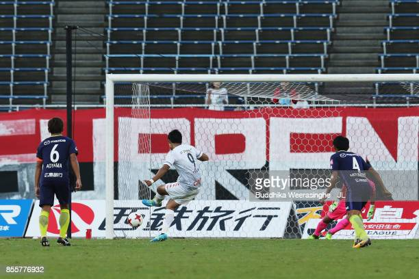 Ken Tokura of Consadole Sapporo converts the penalty to score his side's first goal during the JLeague J1 match between Sanfrecce Hiroshima and...