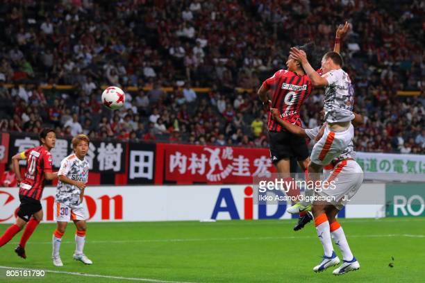Ken Tokura of Consadole Sapporo heads the ball during the JLeague J1 match between Consadole Sapporo and Shimizu SPulse at Sappaoro Dome on July 1...