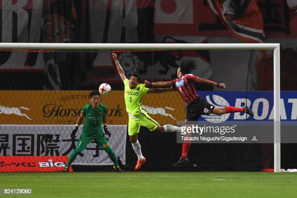 Ken Tokura of Consadole Sapporo heads the ball to score the opening goal during the JLeague J1 match between Consadole Sapporo and Urawa Red Diamonds...