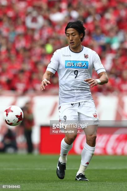 Ken Tokura of Consadole Sapporo in action during the JLeague J1 match between Urawa Red Diamonds and Consadole Sapporo at Saitama Stadium on April 22...