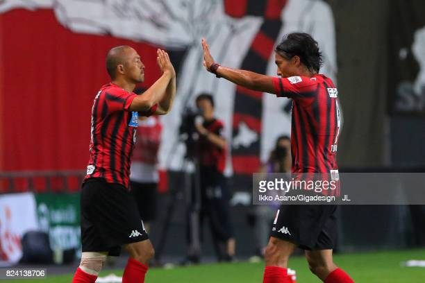 Ken Tokura of Consadole Sapporo is replaced by Shinji Ono during the JLeague J1 match between Consadole Sapporo and Urawa Red Diamonds at Sapporo...
