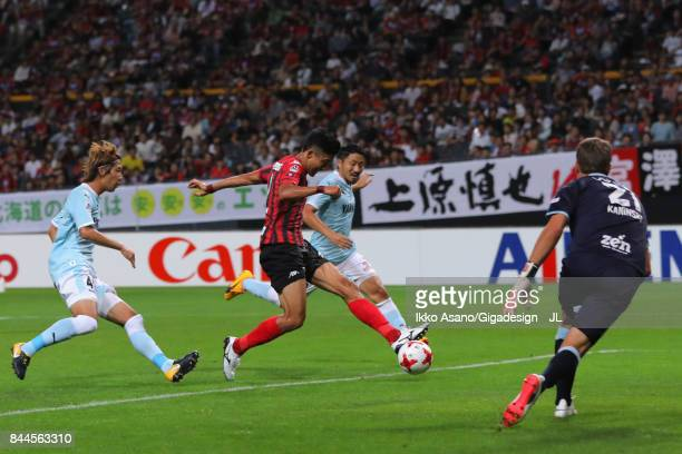 Ken Tokura of Consadole Sapporo scores his side's first goal during the JLeague J1 match between Consadole Sapporo and Jubilo Iwata at Sapporo Dome...