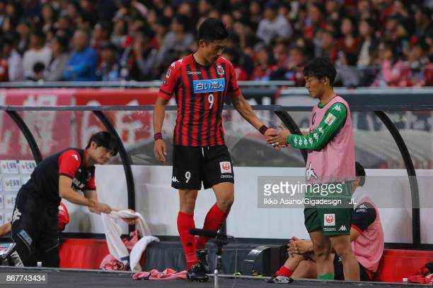 Ken Tokura of Consadole Sapporo shakes hands with Junki Kanayama after substituted during the JLeague J1 match between Consadole Sapporo and Kashima...