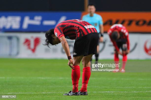 Ken Tokura of Consadole Sapporo shows dejection after his side's 02 defeat in the JLeague J1 match between Consadole Sapporo and Gamba Osaka at...