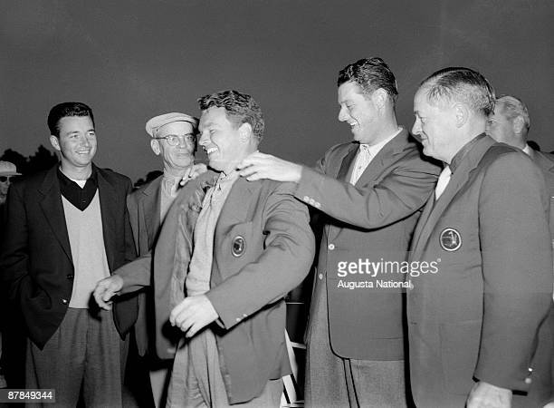 Ken Venturi Clifford Roberts and Bobby Jones far right watch as Jack Burke Jr receives a Green Jacket from Cary Middlecoff during the 1956 Masters...