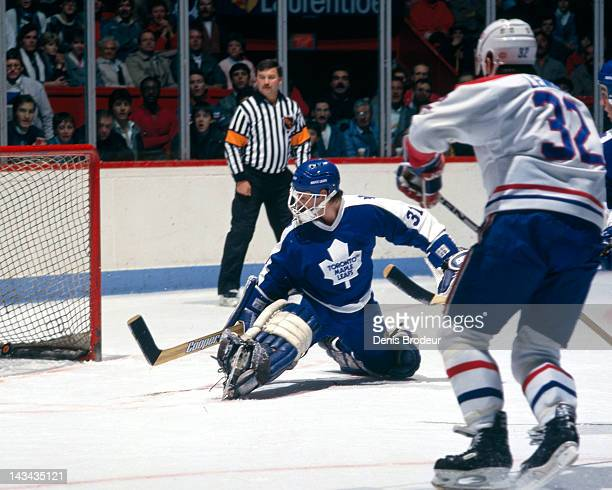 Ken Wregget of the Toronto Maple Leafs watches as a shot by Claude Lemieux of the Montreal Canadiens enters the net Circa 1988 at the Montreal Forum...
