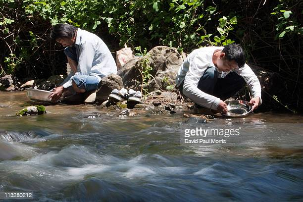 Ken Yong and Ted Nguyan both of San Jose look for gold in Woods Creek on April 29 2011 in Jamestown California As the dollar continues to fall gold...