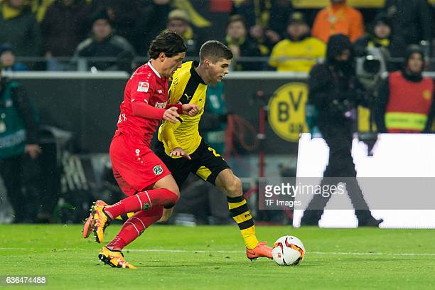 Kenan KARAMAN of Hannover 96 and Christian Pulisic of Borussia Dortmund battle for the ball during the Bundesliga match between Borussia Dortmund and...