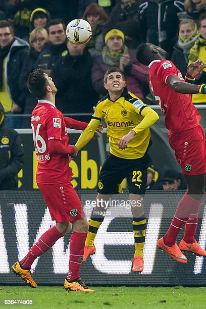Kenan KARAMAN of Hannover 96 Christian Pulisic of Borussia Dortmund and Andre HOFFMANN of Hannover 96 battle for the ball during the Bundesliga match...