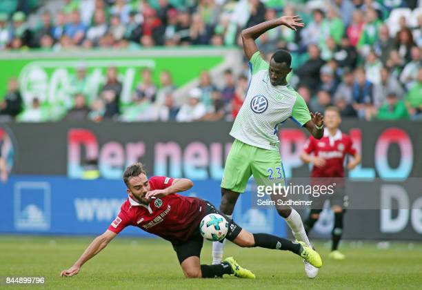 Kenan Karaman of Hannover 96 fights for the ball with Josuha Guilavogui of VfL Wolfsburg during the Bundesliga match between VfL Wolfsburg and...