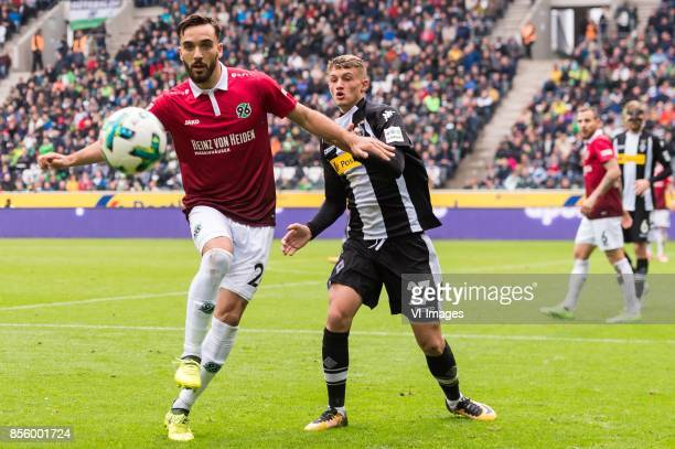 Kenan Karaman of Hannover 96 Michael Cuisance of Borussia Monchengladbach during the Bundesliga match between Borussia Monchengladbach and Hannover...