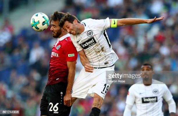 Kenan Karaman of Hannover and David Abraham of Frankfurt head for the ball during the Bundesliga match between Hannover 96 and Eintracht Frankfurt at...