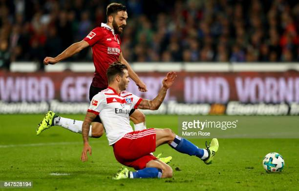 Kenan Karaman of Hannover and Dennis Diekmeier of Hamburg battle for the ball during the Bundesliga match between Hannover 96 and Hamburger SV at...