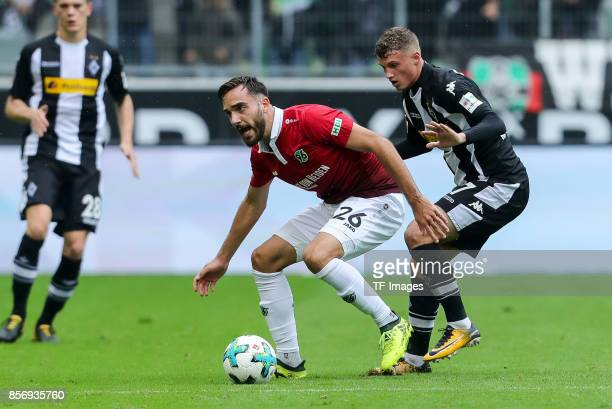 Kenan Karaman of Hannover and Mickaael Cuisance of Moenchengladbach battle for the ball during the Bundesliga match between Borussia Moenchengladbach...