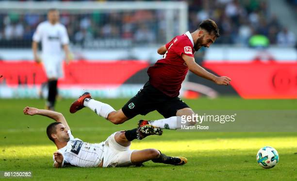 Kenan Karaman of Hannover and Mijat Gacinovic of Frankfurt battle for the ball during the Bundesliga match between Hannover 96 and Eintracht...