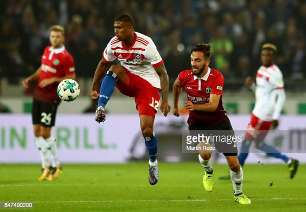 Kenan Karaman of Hannover and Walace of Hamburg battle for the ball during the Bundesliga match between Hannover 96 and Hamburger SV at HDIArena on...