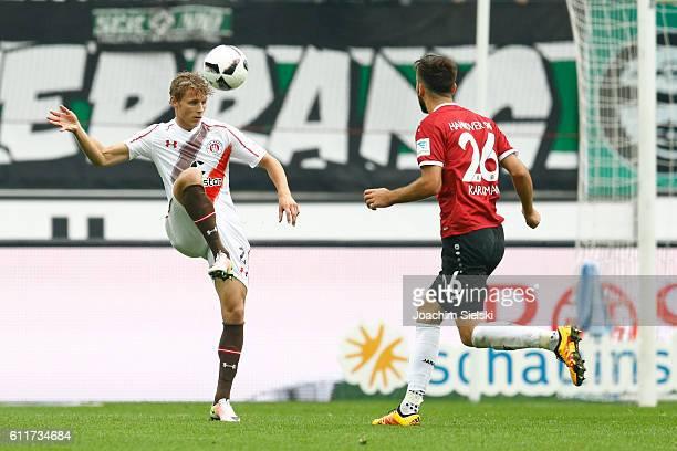 Kenan Karaman of Hannover challenges Vegar Eggen Hedenstad of St Pauli during the Second Bundesliga match between Hannover 96 and FC St Pauli at...