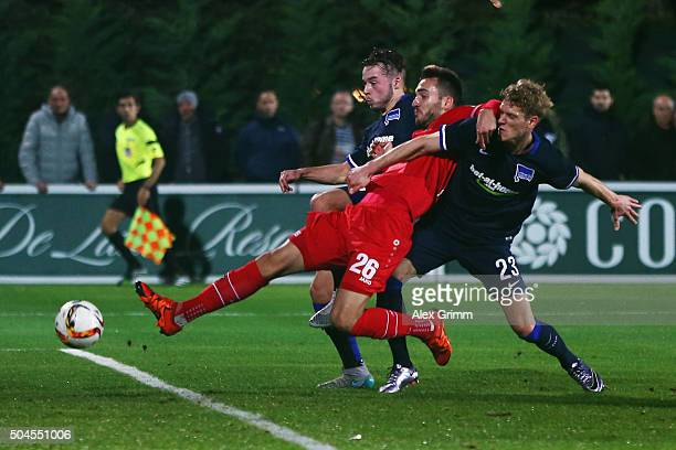 Kenan Karaman of Hannover is challenged by Yanni Regaesel and Johannes van den Bergh of Berlin during a friendly match between Hannover 96 and Hertha...