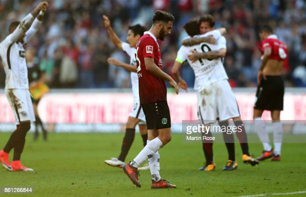 Kenan Karaman of Hannover looks dejected after the Bundesliga match between Hannover 96 and Eintracht Frankfurt at HDIArena on October 14 2017 in...
