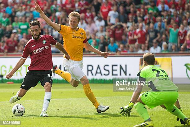 Kenan Karaman of Hanover Marco Hartmann of Dresden and goalkeeper Marvin Schaebe of Dresden in action during the Second Bundesliga match between...