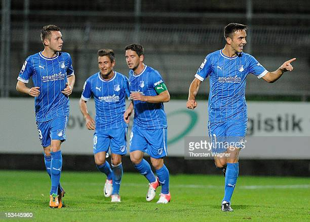 Kenan Karaman of Hoffenheim celebrates after scoring his teams first goal during the fourth league match between SV Elversberg and TSG 1899...