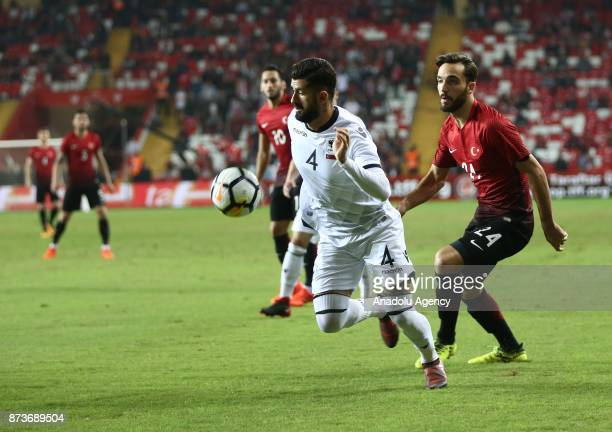 Kenan Karaman of Turkey in action against Elseid Hysaj of Albania during the Friendly match between Turkey and Albania at Antalya Stadium on November...