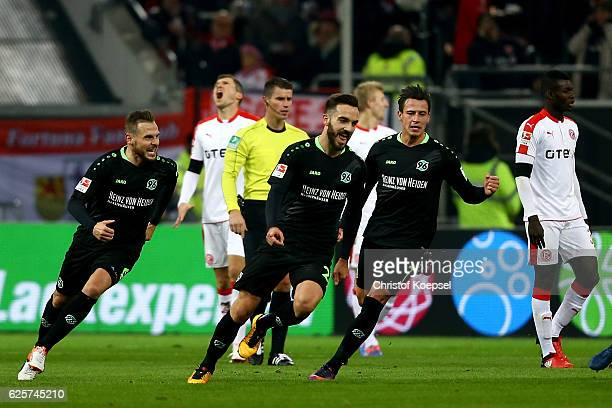 Kenan Karman of Hannover celebrates the first goal with Marvin Bakalorz and Edgar Prib during the Second Bundesliga match between Fortuna Duesseldorf...