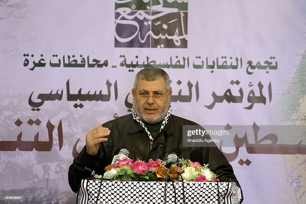 Kenan Obaid, the chairman of the Palestinian engineers syndicate in Gaza speaks to the media when Palestinian members of unions and political parties attend a conference discussed the peace talks with Israel in Gaza City, Gaza Strip on January 23, 2014.