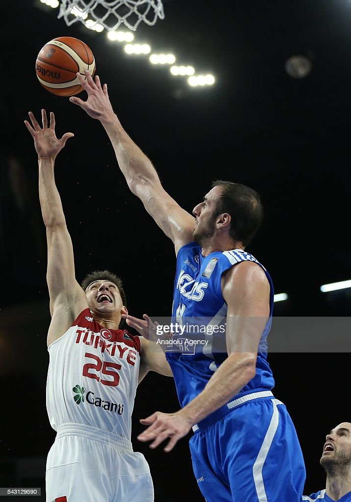 Kenan Sipahi (25) of Turkey in action against Giannis Athinaiou (4) of Greece during the friendly match at Abdi Ipekci Sports Hall in Istanbul, Turkey on June 26, 2016.