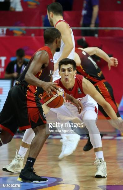 Kenan Sipahi of Turkey in action against Jonathan Tabu of Belgium during the FIBA Eurobasket 2017 Group D Men's basketball match between Turkey and...