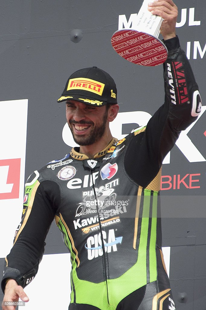 Kenan Sofuoglu of Turkey and Kawasaki Puccetti Racing celebrates the victory on the podium at the end of the Supersport race during the World Superbikes - Race at Enzo & Dino Ferrari Circuit on May 10, 2015 in Imola, Italy.