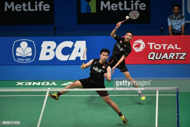 Kenas Adi Haryanto and Moh Reza Pahlevi Isfahani of Indonesia compete against Hendra Setiawan of Indonesia and Boon Heong Tan of Malaysia during...