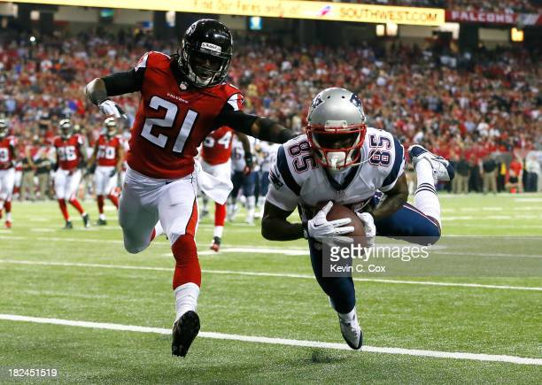 Kenbrell Thompkins of the New England Patriots pulls in this touchdown reception against Desmond Trufant of the Atlanta Falcons at Georgia Dome on...