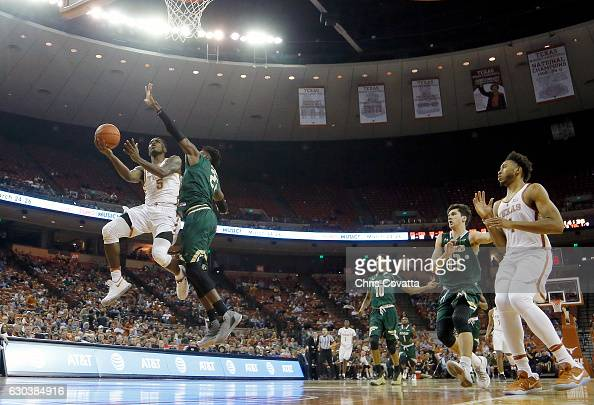 Kendal Yancy of the Texas Longhorns shoots over Tosin Mehinti of the UAB Blazers at the Frank Erwin Center on December 21 2016 in Austin Texas