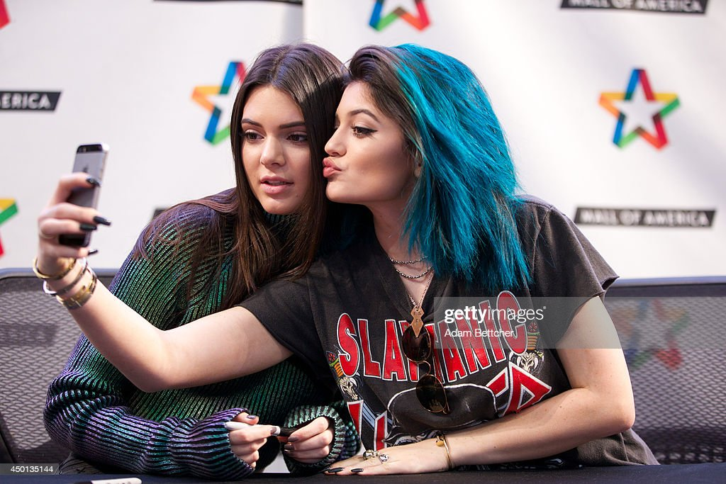 Kendall and Kylie Jenner sign copies of their book 'Rebels City of Indra' at the Mall of America on June 5 2014 in Bloomington Minnesota