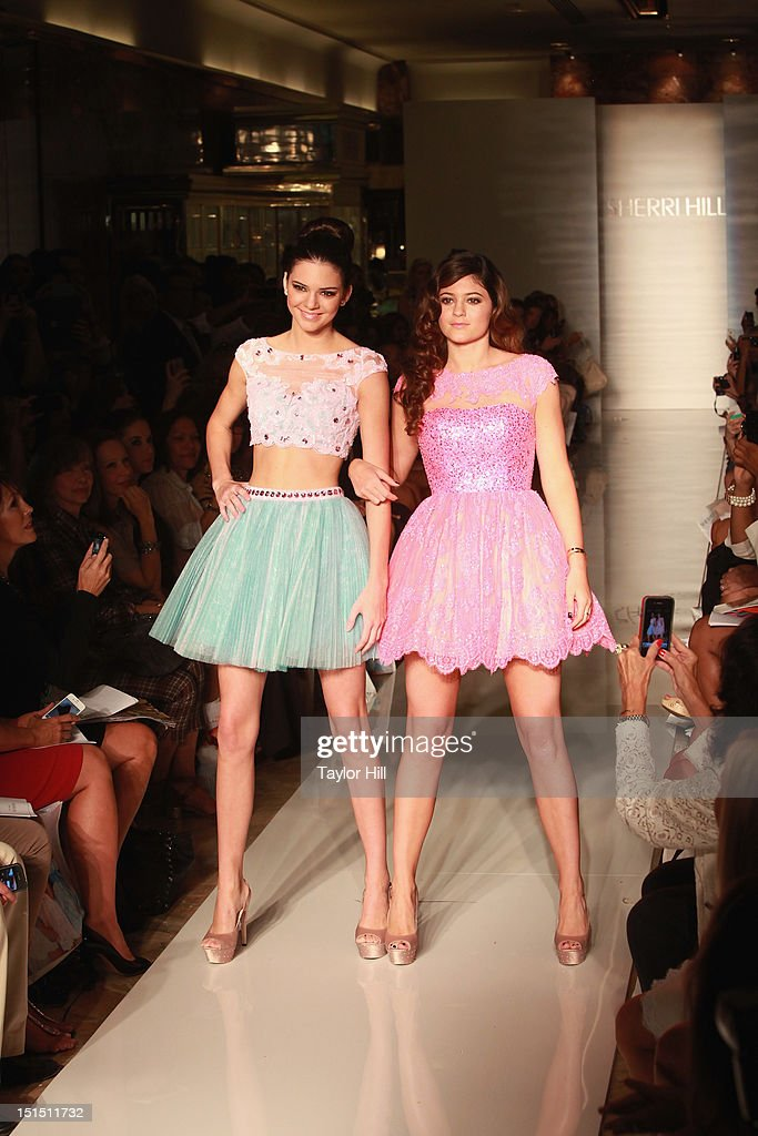 Kendall and Kylie Jenner walk the runway at the Evening Sherri Hill spring 2013 fashion show during Mercedes-Benz Fashion Week at Trump Tower Grand Corridor on September 7, 2012 in New York City.