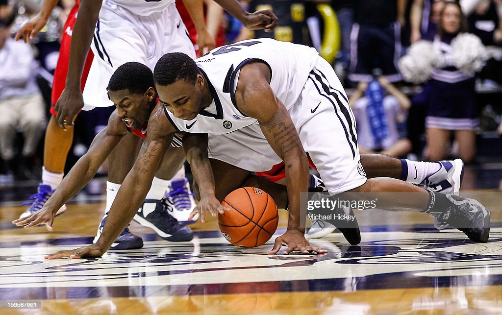 Kendall Anthony #0 of the Richmond Spiders and Roosevelt Jones #21 of the Butler Bulldogs battle for a loose ball at Hinkle Fieldhouse on January 16, 2013 in Indianapolis, Indiana. Butler defeated Richmond 62-47.