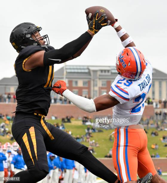 Kendall Blanton of the Missouri Tigers catches a touchdown pass against Jeawon Taylor of the Florida Gators in the first quarter at Memorial Stadium...
