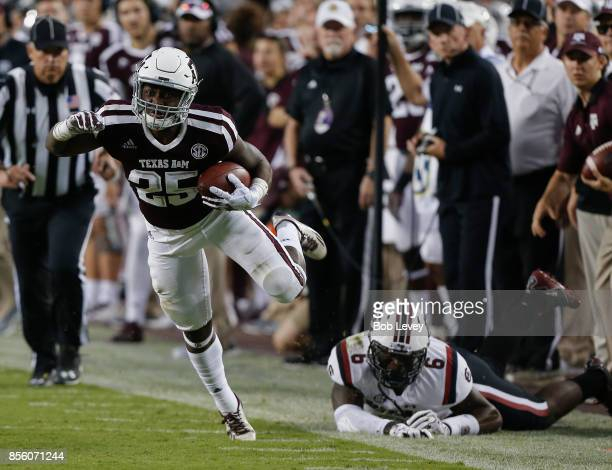 Kendall Bussey of the Texas AM Aggies avoids a tackle attempt by TJ Brunson of the South Carolina Gamecocks in the second quarter at Kyle Field on...