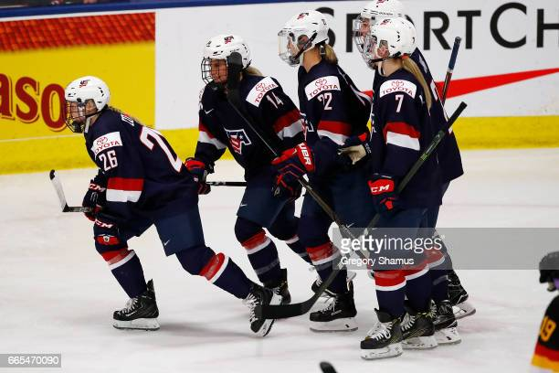 Kendall Coyne of the United States celebrates her second period goal with teammates while playing Germany during a semifinal game at the 2017 IIHF...