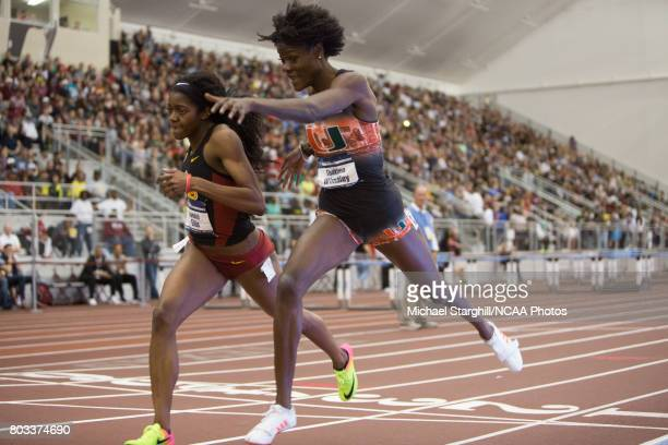 Kendall Ellis of USC and Shakima Wimbley of Miami compete in the 400 meter dash during the Division I Men's and Women's Indoor Track Field...