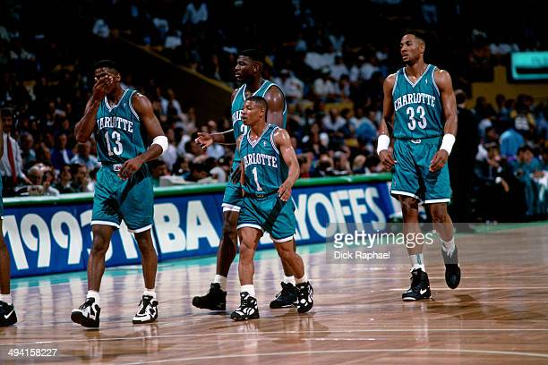 Kendall Gill Larry Johnson Muggsy Bogues and Alonzo Mourning of the Charlotte Hornets walk up the court during a game against the Boston Celtics...