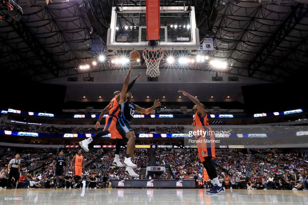 Kendall Gill #12 of Power attempts a shot while being guarded by Ruben Patterson #21 of 3's Company during week six of the BIG3 three on three basketball league at American Airlines Center on July 30, 2017 in Dallas, Texas.