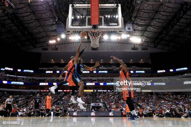 Kendall Gill of Power attempts a shot while being guarded by Ruben Patterson of 3's Company during week six of the BIG3 three on three basketball...